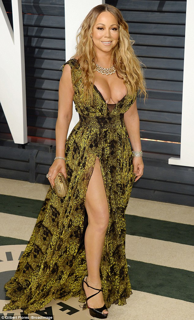 Mariah Carey stuns in a low neckline gown for the 2017 Oscars ...
